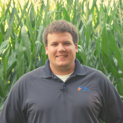 Josh Fosenberg standing in field treated with herbicide resistant weeds.